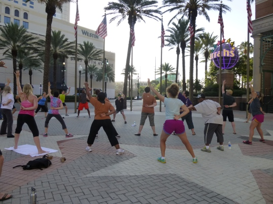 KScope attendees starting the day with Morning Chi Gung on the plaza in front of Harahs casino.
